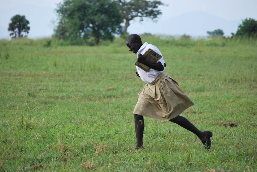 Running Uganda girl - young student